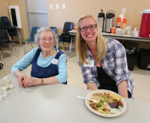 Retired Board Member Wilma Blackman and General Manager Sarah Christensen grab a bite at the Annual Owner Meeting.
