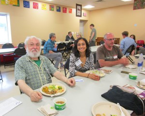 Board Members Talat and Aiman enjoy a snack at the 2015 Annual Meeting.