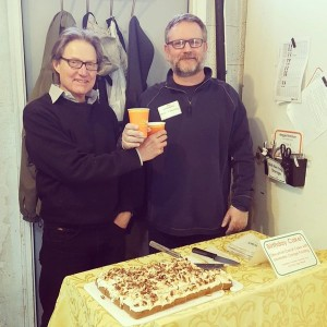 Two Board Member (Gary and Robert) serve up cake and coffee for GreenTree's 46th birthday!